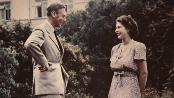 Princess-Elizabeth-the-future-Queen-Elizabeth-II-conversing-with-her-father-King-George-VI-1895-1952-in-a-garden.jpg