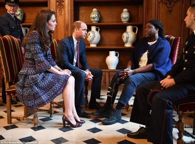 3E64FFBC00000578-4326466-Prince_William_and_Catherine_Duchess_of_Cambridge_visit_Les_Inva-a-77_1489839841921.jpg