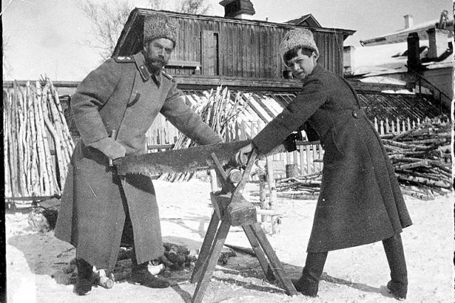 nicholas-ii-and-tsarevich-alexey-nikolaevich-sawing-wood-at-tobolsk-in-1917.jpg