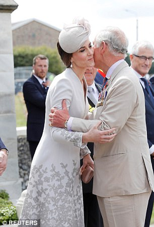 42D8191D00000578-4748050-Prince_Charles_greets_Catherine_the_Duchess_of_Cambridge-a-30_1501546117325.jpg
