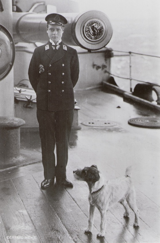 HRH Edwardm Prince of Wales, and a terrier on board HMS 'Hindust